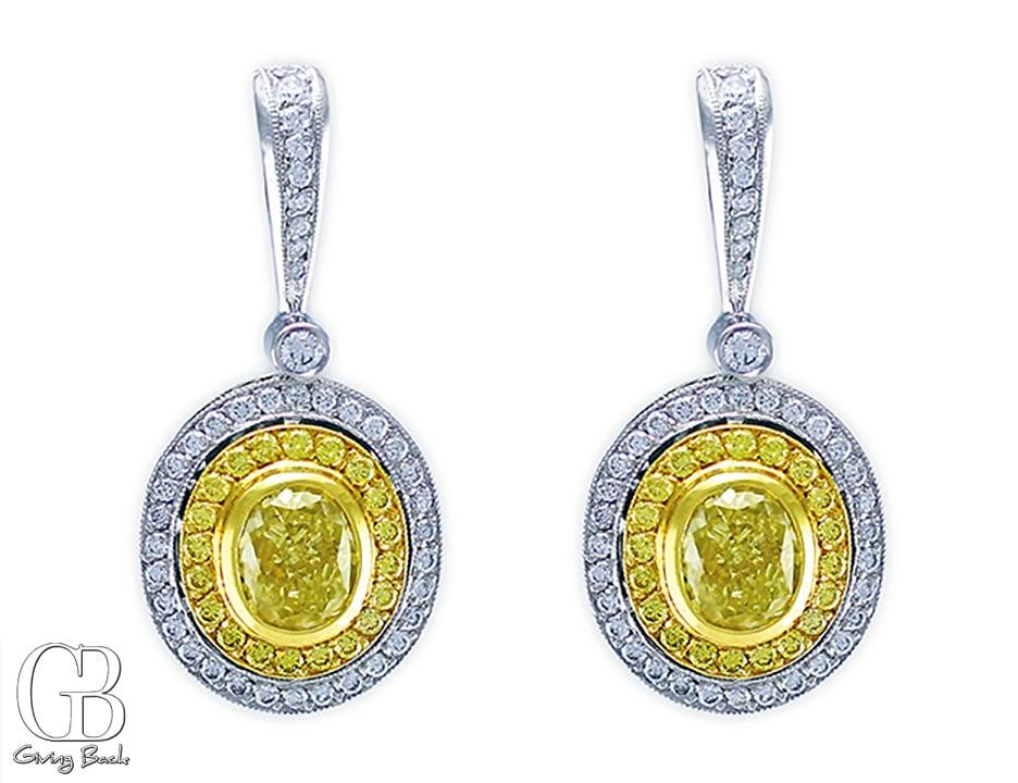 . ct Fancy Yellow Oval Diamond Earrings