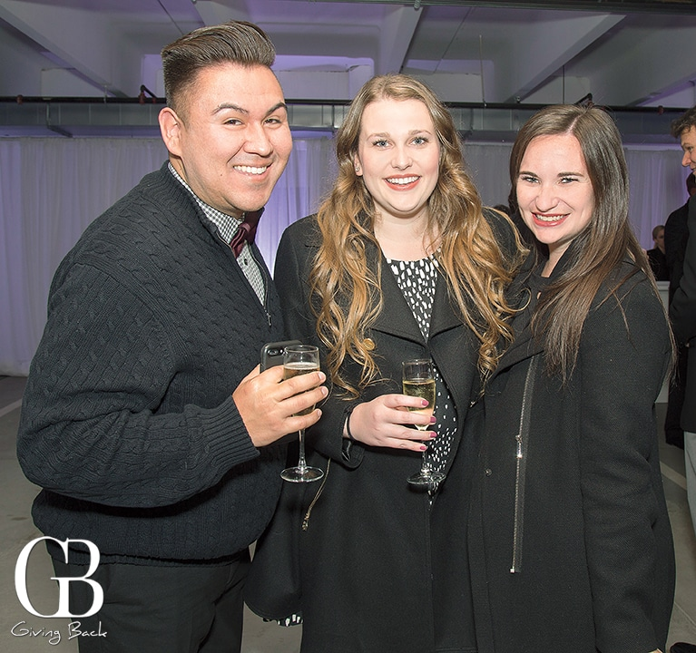 Andrew Tisnado with Megan and Molly Cunningham