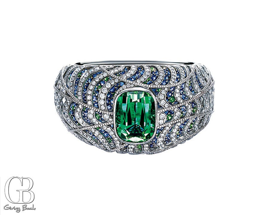 Bracelet in platinum with a green tourmaline  tsavorite  sapphire and diamond