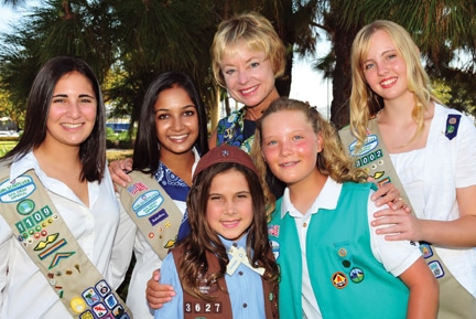 CEO Jo Dee C. Jacob with Girl Scouts I have higher res version if necessary