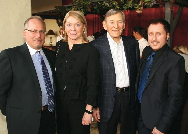 Clinton Walters with Joyce and Edward Glazer and Vince Heald.JPG