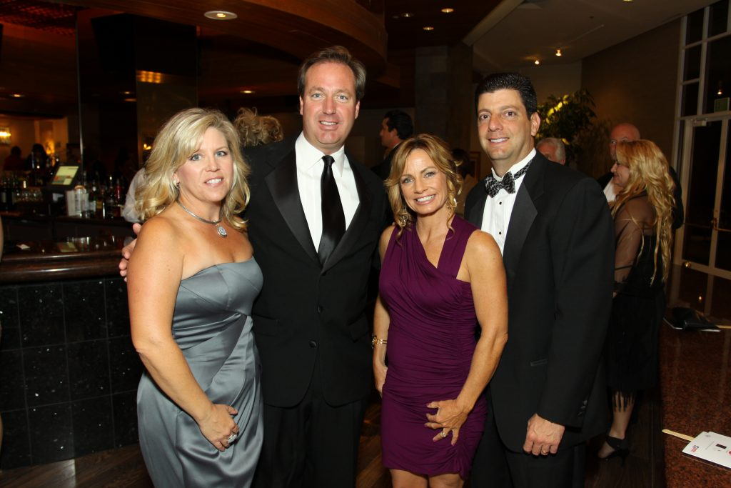 Jennifer and Joseph Reges with  Lori and Pat Mendes.JPG