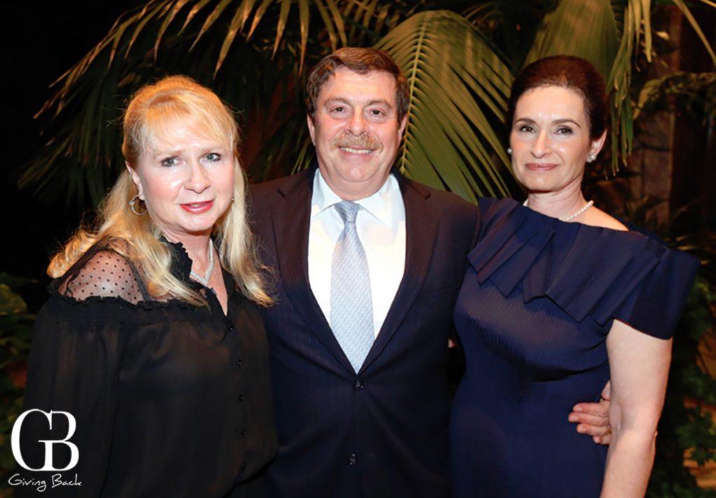 Joanna Schulmann with Claude and Veronique Benchimol