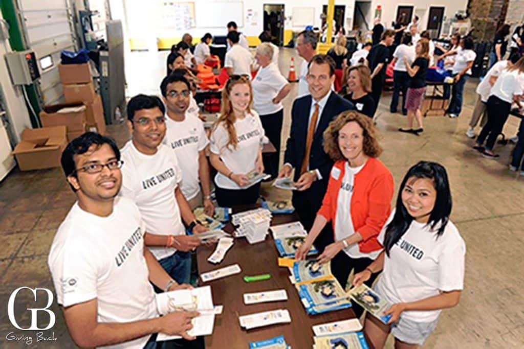Linda Katz volunteering at the San Diego Food Bank with other United Way of San Diego County volunteers