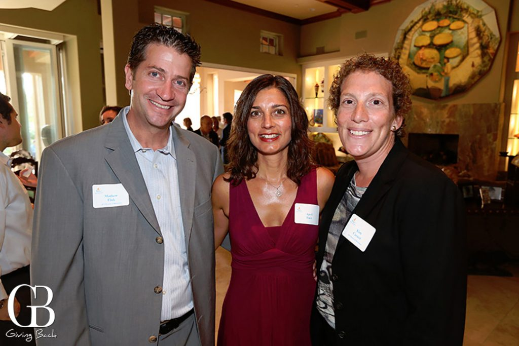 Matthew and April Fink with Kim Carnot