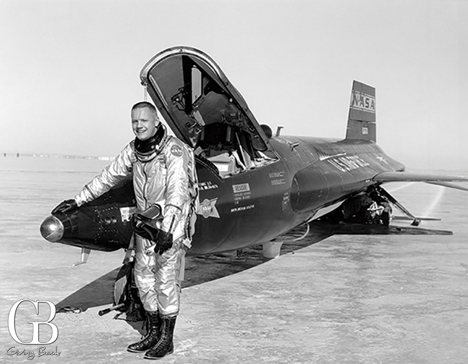 Neil Armstrong next to the X