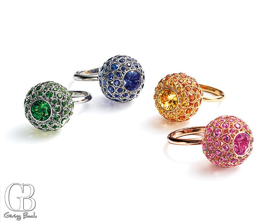 Rings in platinum  k yellow and rose gold with tsavorites   sapphires  spessartites  and pink sapphires