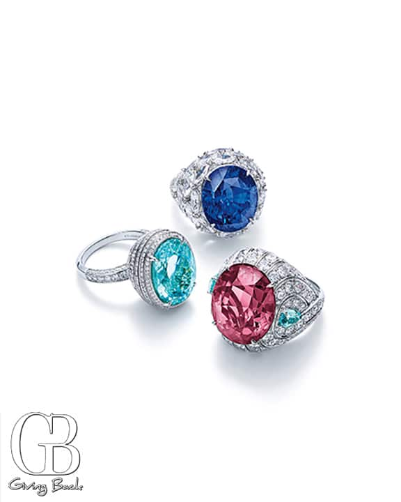 Rings of blue sapphire  marquise shaped diamonds  pink spinel  blue cuprian elbaite tourmalines and round diamonds