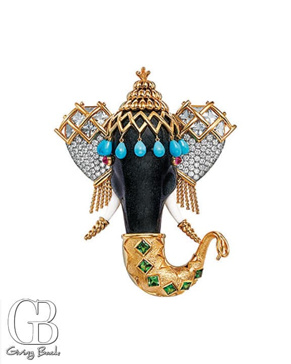 Schlumberger elephant clip in K yellow gold and platinum with diamonds