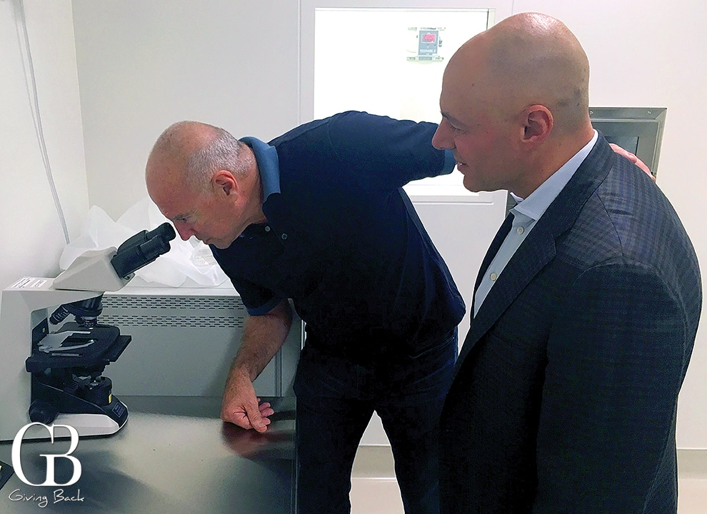 The late Ralph Whitworth observing the expansion of human t cells being processed in the Immunotherapy Foundation Advanced Cellular Therapy Lab .jpeg