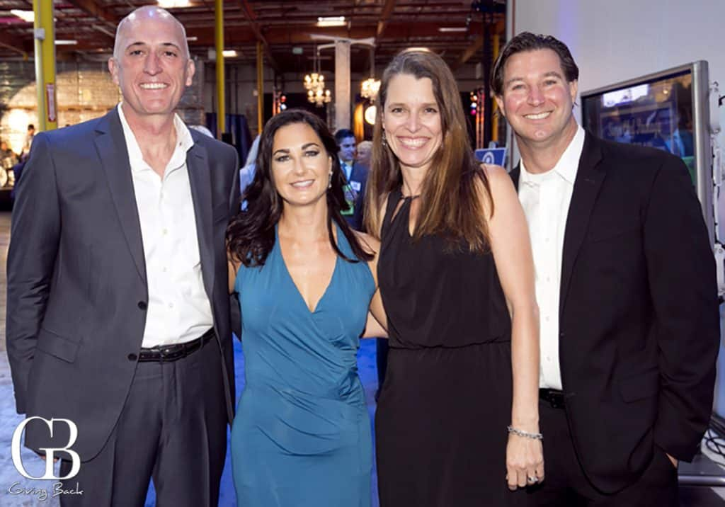 Tony and Jennifer Schwarz with Michelle and Michael Hanlon